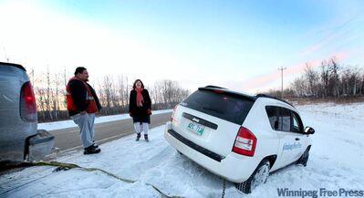 Peter Baptiste comes to the rescue after reporter Mary Agnes Welch slid off the road.