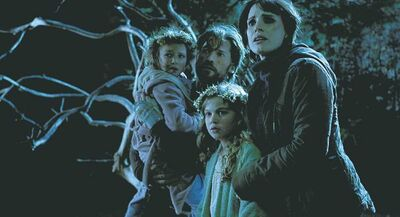"This film image released by Universal Pictures shows, from left, Isabelle N�lisse, Nikolaj Coster-Waldau, Megan Charpentier and Jessica Chastain in a scene from ""Mama."" (AP Photo/Universal Pictures)"