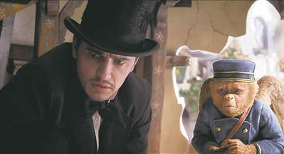 This film image released by Disney Enterprises shows James Franco, as Oz, left, and the character Finley, voiced by Zach Braff, in a scene from Oz the Great and Powerful.
