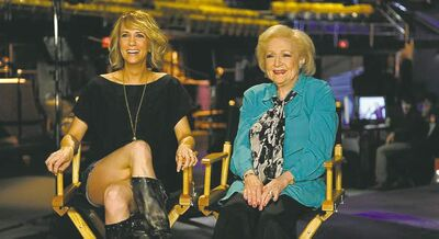 Kristen Wiig (left) and Betty White on SNL set. White won an Emmy for her 2010 guest appearance.