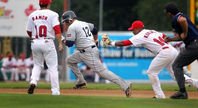 Winnipeg Goldeyes second baseman Price Kendall reaches to tag out Les Capitales de QuébecJosue Peley between second and third at Shaw Park Tuesday.