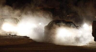 Cold early-morning temperatures created heavy exhaust fog for motorists.