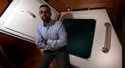 Roi Jones, co-owner of Flotation Therapy Winnipeg, poses with their sensory deprivation tank.