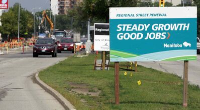 A 'Steady Growth, Good Jobs' provincial government sign on Pembina Highway. The PCs say they are a waste of money.