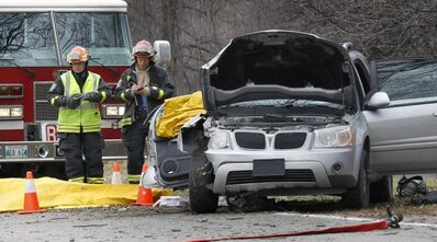 Winnipeg firefighters at the Wellington Crescent crash scene Thursday afternoon.