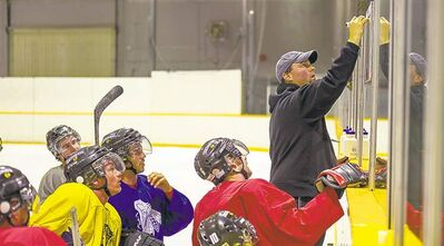 DAVID LIPNOWSKI / WINNIPEG FREE PRESS It's simple boys: Get the puck and score. Hawks head coach Stephen George diagrams a play.