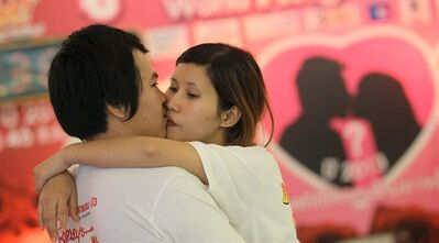 Krittirak Chaikham, left, and Kanokwan Arjkidkorn compete in the World's Longest Continuous Kiss Competition in Pattaya, southeastern Thailand, Thursday, Feb. 14, 2013. The event was held in an attempt to break the Guinness world record and to celebrate Valentine's Day. (AP Photo/Sakchai Lalit)