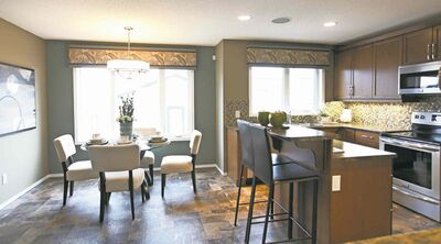 An extra-wide entrance allows for seamless entry into the kitchen/dinette area.