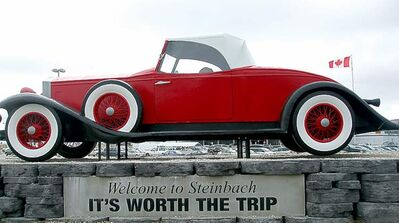 Big Red Car welcomes folks to Steinbach.