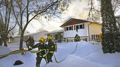Firefighters battle a blaze at a split-level home at 54 Merrill Cres., which claimed the life of a man inside.