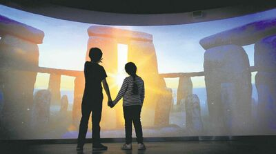 English Heritage Stonehenge exhibition and visitor centre. The virtual 360-degree experience which lets visitors 'stand in the stones' before they enter the gallery. This three-minute film, based on state-of-the-art laser scan images of the stone circle, transports the viewer back in time through the millennia and enables them to experience the summer and winter solstices.