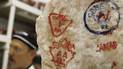 Inspection stamps on Canadian beef are shown in a butcher shop in Toronto in this May 22, 2003, file photo. THE CANADIAN PRESS/Kevin Frayer