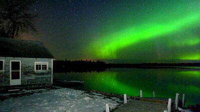 The Aurora Borealis is seen in Whiteshell Provincial Park, which is Manitoba's largest at 3,300 cottages. Owners are anxious about incoming fee increases.