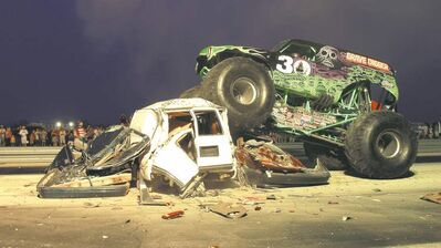 Grave Digger not only tore down the track at Interlake Dragway last Saturday, the massive monster truck also crushed a few cars.
