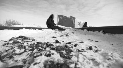 JOHN WOODS / THE CANADIAN PRESSA demonstrator blocks a CN track west of Portage la Prairie Wednesday. The protest was held to highlight aboriginal treaty rights.