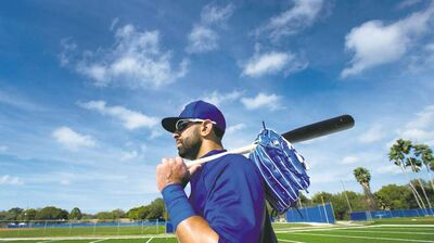 Toronto Blue Jays outfielder Jose Bautista leaves the park after batting practice during baseball spring training in Dunedin, Fla., on Friday, Feb. 22, 2013. THE CANADIAN PRESS/Nathan Denette