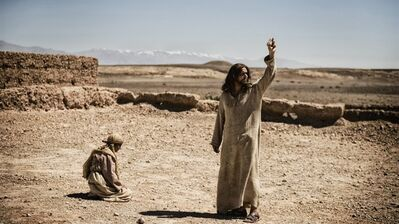 """This publicity image released by History shows Diogo Morcaldo as Jesus, right, in a scene from """"The Bible,"""" on History. The producers of the cable TV miniseries on the Bible say Internet chatter that their Satan character resembles President Barack Obama is """"utter nonsense."""" Mark Burnett and Roma Burnett said Monday the Moroccan actor who played Satan in the History channel series has played Satanic characters in other Biblical programs long before Obama was elected president. (AP Photo/History, Joe Alblas)"""