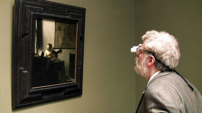Tim Jenison studies the The Music Lesson by Johannes Vermeer.