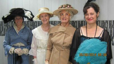 "Costume Museum of Canada volunteers who modelled in the First World War costume review at McNally Robinson Booksellers on Aug. 25 were (left): Christine Robinson, wearing a 1911 Paul Poiret-designed ""hobble dress""; Karen Couch, wearing a 1916 replica embroidered silk dress and matching hat; Maralyn Mackay-Hussain wearing a 1916 trousseau suit in gabardine and a flower-trimmed hat; and Susanne Wastle wearing a 1918 Sally Milgram model gown with feathers and sequin trim and feather fan as an accessory."