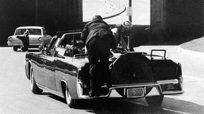"In this Friday, Nov. 22, 1963 file photo, President John F. Kennedy slumps down in the back seat of the Presidential limousine as it speeds along Elm Street toward the Stemmons Freeway overpass in Dallas after being fatally shot. THE CANADIAN PRESS/AP, James W. ""Ike"" Altgens"