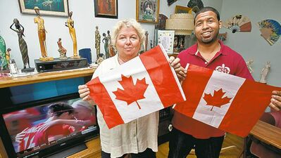 COLE BREILAND / WINNIPEG FREE PRESS  Desiree Scott's mother, Charlene Gusberti, and brother, Nick Scott, show their pride.