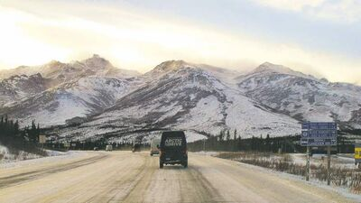 The cavalcade of Mercedes-Benz Sprinters on the George Parks Highway near Mt. Healy, Alaska.