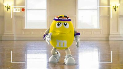 This image provided by Mars Inc. shows an online teaser ad for M&M's Super Bowl ad featuring its yellow peanut M&M 'spokescandy.'