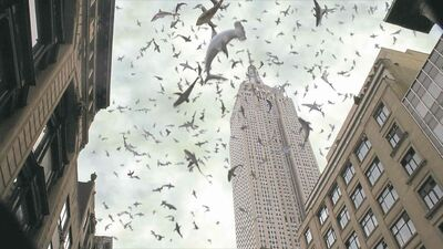 Sharks fall past the Empire State Building.