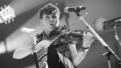 Arcade Fire violinist Sarah Neufeld onstage Thursday.
