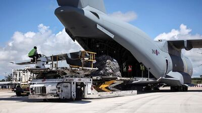 In this undated photo provided on Sunday Sept. 10, 2017, by the British Ministry of Defence, the RAF A400M arrives on the British Virgin Islands to provide humanitarian assistance to British overseas territories. The death toll from Hurricane Irma has risen to 22 as the storm continues its destructive path through the Caribbean. (Joel Rouse/MOD via AP)