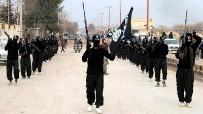 This undated file image posted on a militant website on Tuesday, Jan. 14, 2014, which has been verified and is consistent with other AP reporting, shows fighters from the al-Qaida linked Islamic State of Iraq and the Levant (ISIL) marching in Raqqa, Syria.