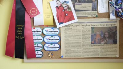 ZACHARY PRONG / WINNIPEG FREE PRESS</p><p>A bulletin board in Piper Coffin&#39;s room adorned with ribbons, patches and an article about her liver transplant. </p>