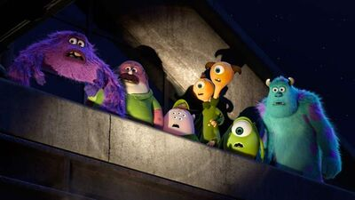 In the spotlight: Mike (second from right) and Sully (right) and the other members of their sad-sack fraternity earn adequate grades in Monsters University.