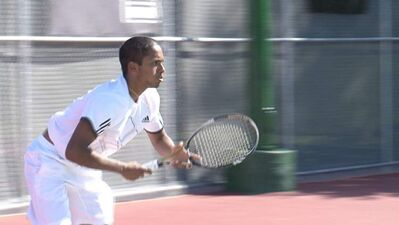 Three-time Manitoba open doubles champion Museen Ismath waits for the serve in the qualifying round of the Manshield Tennis Futures tournament at Sargent Park Tennis Lawn.