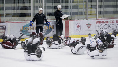 The St. Paul's Crusaders, the reigning Winnipeg High School Hockey League champs, are put through the paces during practice at the MTS Iceplex Tuesday.