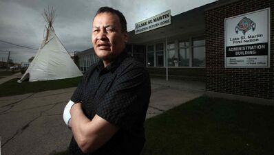 Lake St. Martin Chief Adrian Sinclair, at the band's Winnipeg office, says: 'Give us our community back before we're all assimilated. We're not begging. We're asking for what's rightfully ours.'