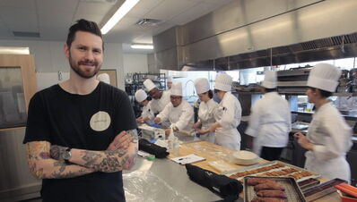 Segovia tapas bar and restaurant chef and owner Adam Donnelly poses with Red River College Culinary Arts students. Adam is the poster boy for the culinary school's hopes for a program that would annually send students on an international internship to broaden their knowledge and experience and hopefully bring what they learn back to a city restaurant, as Adam did so well — at his own expense.