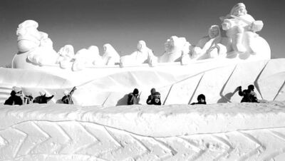 WAYNE GLOWACKI/WINNIPEG FREE PRESS  School children walk past  �The Great Canoe� snow sculpture at the  entrance of Voyageur Park made by David MacNair, Barry Bonham and Dave Maddocks, Jim Alexander and Randy Scott as the Festival du Voyageur  runs until February 18.      Feb 14  2007
