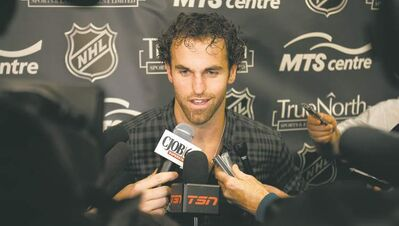 BORIS MINKEVICH / WINNIPEG FREE PRESS ARCHIVESWinnipeg Jets captain Andrew Ladd says he didn�t know about the sale of the Atlanta Thrashers to True North Sports & Entertainment until the day it happened.
