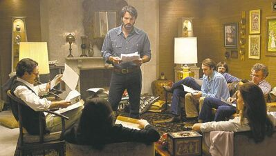 WARNER BROS. PICTURESBen Affleck (top and above, centre) portrays a CIA agent tasked with rescuing U.S. diplomats from Tehran.