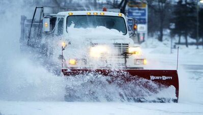 A city snowplow clears snow along Pembina Highway earlier this month.