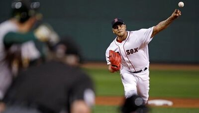 Boston Red Sox starting pitcher Eduardo Rodriguez delivers during the first inning of a baseball game against the Oakland Athletics at Fenway Park in Boston, Tuesday, Sept. 12, 2017. (AP Photo/Charles Krupa)