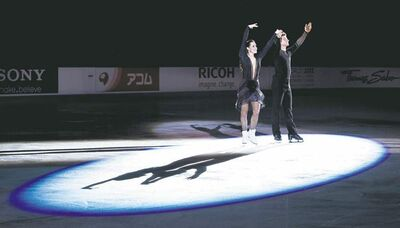 Paul Chiasson / the canadian pressCanada�s Tessa Virtue and Scott Moir salute the crowd during victory ceremonies in Windsor, Ont., on Saturday.