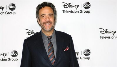 "FILE - In this Jan. 10, 2013 file photo, Brad Garrett attends the Disney ABC Winter TCA Tour at the Langham Huntington Hotel, in Pasadena, Calif. The comic and Emmy-winning actor from ""Everybody Loves Raymond"" has a deal with Gallery Books for the memoir ""When the Balls Drop: How I Learned to Give Up, Stop Trying, and Enjoy Life's Second Half."" Gallery, an imprint of Simon & Schuster, announced Thursday, Oct. 17, 2013, that the book is scheduled for 2015. (Photo by Richard Shotwell/Invision/AP, File)"
