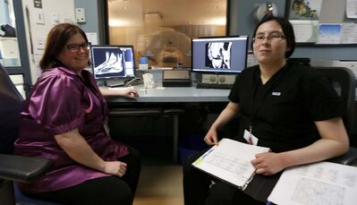 WAYNE GLOWACKI / WINNIPEG FREE PRESS</p><p>Pan Am Clinic MRI technologist Chrissy Mutual (left) with Grade 10 student Trina White from Children of the Earth High School. </p>