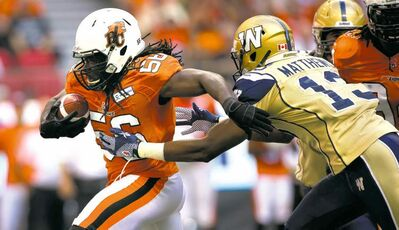 Darryl Dyck / The Canadian PressB.C. Lions� Solomon Elimimian lugs the ball after intercepting a Winnipeg Blue Bombers pass as receiver Chris Matthews gives chase.