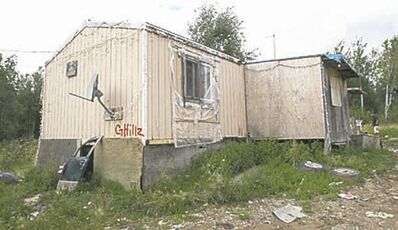 The outside view of the  trailer of Richard Andrews in Wasagamack First Nation.  It is in filthy condition, has mold and is overpopulated by over 13 people living inside. It has  no running water- See Mary Agnes No Running Water Feature � August 18, 2011   (JOE BRYKSA / WINNIPEG FREE PRESS)