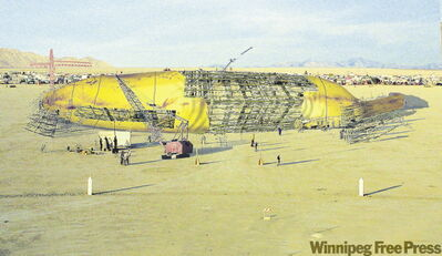 Artists rendering shows giant banana to be flown over Texas. The Canada Council for the Arts won national Teddy for earmarking $40,000 for the project.