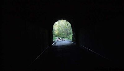 Cyclists must disembark to traverse the three dank, dark and wonderfully spooky old train tunnels of the Elroy-Sparta trail.