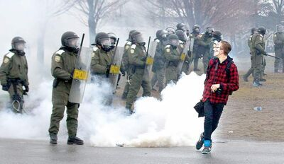 Phil Carpenter / Postmedia NewsA protester jeers at riot police during demonstrations outside the convention of the Quebec Liberal Party in Victoriaville, Que., Friday.